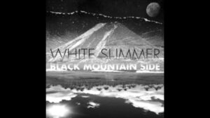 white summer black mountain side